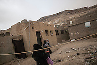 Wednesday 15 July, 2015: Displaced women from the heavy fighting and bombarments in Sa'dah governorate are seen in an abandoned salafist madrasa (university) in Dammaj village, used as a temporary settlement in the northern province of Sa'dah, the stronghold of the Houthi's movement in Yemen. (Photo/Narciso Contreras)