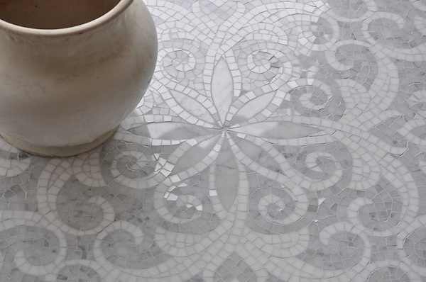 Arabella, a handmade mosaic shown in polished hand-cut and waterjet-cut Carrara and Thassos, is part of the Silk Road Collection by Sara Baldwin for New Ravenna.<br /> <br /> For pricing, samples and design help, please click here: http://www.newravenna.com/showrooms/