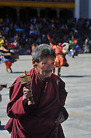A bhutanese man with a prayer wheel in his hand entering Thimpu Dzong for Annual Tsechu festival. Arindam Mukherjee