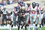 Vanderbilt wide receiver Jonathan Krause (17) is tackled by Ole Miss' Wesley Pendleton (6) and Ole Miss' Aaron Garbutt(20) in Nashville, Tenn. on Saturday, September 17, 2011. Vanderbilt won 30-7..