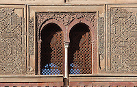 Latticed windows and carved stucco work on the Wine Gate or Puerta del Vino, built 1302-09, later redecorated by Sultan Muhammad V 1350s-90s, the main entrance gate to the medina of the Alhambra, Granada, Andalusia, Spain. The Alhambra was begun in the 11th century as a castle, and in the 13th and 14th centuries served as the royal palace of the Nasrid sultans. The huge complex contains the Alcazaba, Nasrid palaces, gardens and Generalife. Granada was listed as a UNESCO World Heritage Site in 1984. Picture by Manuel Cohen