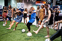 INDIANAPOLIS, IN - APRIL 1, 2011: Jeanette Pohlen, Heather Donaghe and Sarah Boothe kick soccer balls at the Indianapolis Convention Center at Tourney Town during the NCAA Final Four in Indianapolis, IN on April 1, 2011.