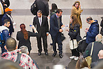 Manhattan, New York, U.S. 4th November 2013. Former Governor DAVID PATERSON, (center L) runs into TOM SUOZZI, Democratic candidate for Nassau County Executive, (center R) in front of the escalators during Suozzi's campaign stop at Penn Station, near end of 36 straight hours of barnstorming across Nassau County, leading up to the November 5 general election. Former Nassau County Executive Suozzi and incumbent Republican Mangano are once again facing each other as challengers.