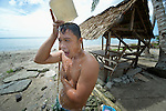 A man bathes in Bacubac, a neighborhood in Basey in the Philippines province of Samar that was hit hard by Typhoon Haiyan in November 2013. The storm was known locally as Yolanda. The ACT Alliance has been providing a variety of forms of assistance to survivors here.