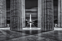The Washington Monument is reflected in the Lincoln Memorial Reflecting Pool as viewed from inside the Lincoln Memorial in the last hour before sunrise in Washington, DC.