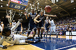 17 December 2013: The ball bounces out of bounds after Duke's Alexis Jones (2) and UConn's Stefanie Dolson (31) and Kaleena Mosqueda-Lewis (23) contested a rebound. The Duke University Blue Devils played the University of Connecticut Huskies at Cameron Indoor Stadium in Durham, North Carolina in a 2013-14 NCAA Division I Women's Basketball game. UConn won the game 83-61.