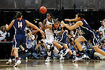 01 APRIL 2012:  Kaleena Mosqueda-Lewis (23) of the University of Connecticut and Devereaux Peters (14) of the University of Notre Dame battle for a loose ball during the Division I Women's Final Four Semifinals at the Pepsi Center in Denver, CO.  Notre Dame defeated UCONN 83-75 to advance to the national championship game.  Jamie Schwaberow/NCAA Photos