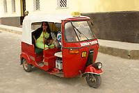 Tuk tuk on a street in the Spanish colonial town of Gracias, Lempira, Honduras......