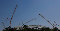 Cranes hold pieces of steel for the roof structure in the Arthur Ashe Stadium at the USTA Billie Jean King National Tennis Center in New York.  06/10/2015. Eduardo MunozAlvarez/VIEWpress