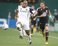 Santino Quaranta #25 of D.C. United loses the ball to Jamison Olave #4 of Real Salt Lake during an MLS match at RFK Stadium, on June 5 2010 in Washington DC. The game ended in a 0-0 tie.