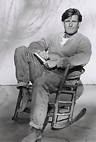 man sitting on rocking chair, portrait (B&amp;W)