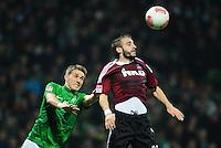 FUSSBALL   1. BUNDESLIGA    SAISON 2012/2013    17. Spieltag   SV Werder Bremen - 1. FC Nuernberg                     16.12.2012 Nils Petersen (li, SV Werder Bremen) gegen Javier Pinola  (re, 1. FC Nuernberg)