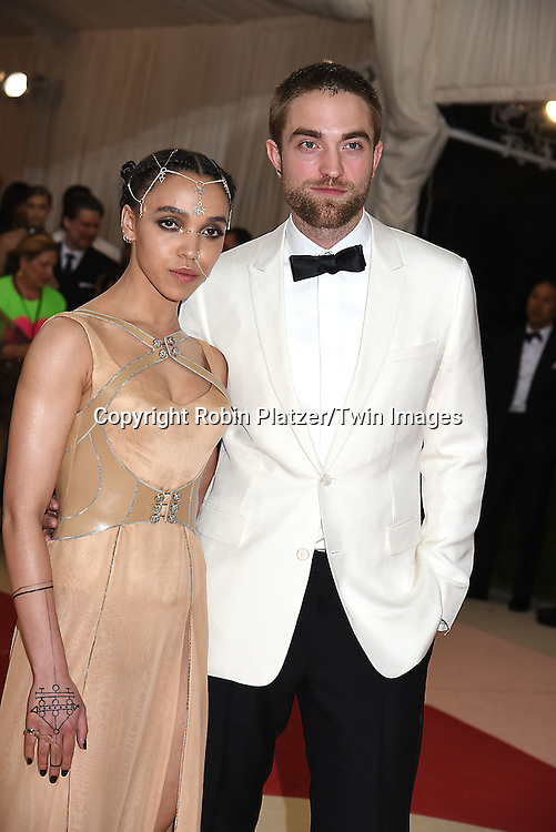 Robert Pattinson and fiancee FKA Twigs attend the Metropolitan Museum of Art Costume Institute Benefit Gala on May 2, 2016 in New York, New York, USA. The show is Manus x Machina: Fashion in an Age of Technology. <br /> <br /> photo by Robin Platzer/Twin Images<br />  <br /> phone number 212-935-0770