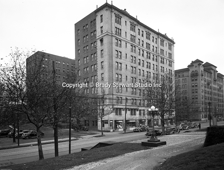 Pittsburgh PA:  View of the Arlington Apartments and Centre Avenue in Shadyside - 1935.  The apartments were built in the early 1900s and has businesses on the first floor; Arlington Pharmacy , Muller's Delicatessen, Arlington Coffee Shop, and Adell's Beauty Shop.