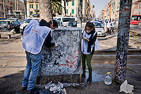 Volunteers clean the archaeological area of Porta Maggiore.<br /> &quot;Wake up Roma ', the great collective mobilization promoted by Retake and Luiss EnLabs for the decorum of the city against the deterioration and abandonment. About three thousand volunteers with scrapers and brushes in hand they removed posters and stickers, clean walls and poles, they cleaned up gardens and flower beds, driveways and sidewalks. Interventions to Piazza Vittorio, Porta Maggiore, Villa Paganini and place Anco Marzio in Ostia. Rome, Italy 12th March 2016