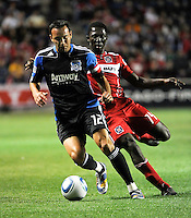 San Jose defender Ramiro Corrales (12) dribbles away from Chicago Fire forward Patrick Nyarko (14) during the first half of a match between the San Jose Earthquakes and the Chicago Fire at Toyota Park in Bridgeview, IL on April 10, 2010.  San Jose Earthquakes 2, Chicago Fire 1.