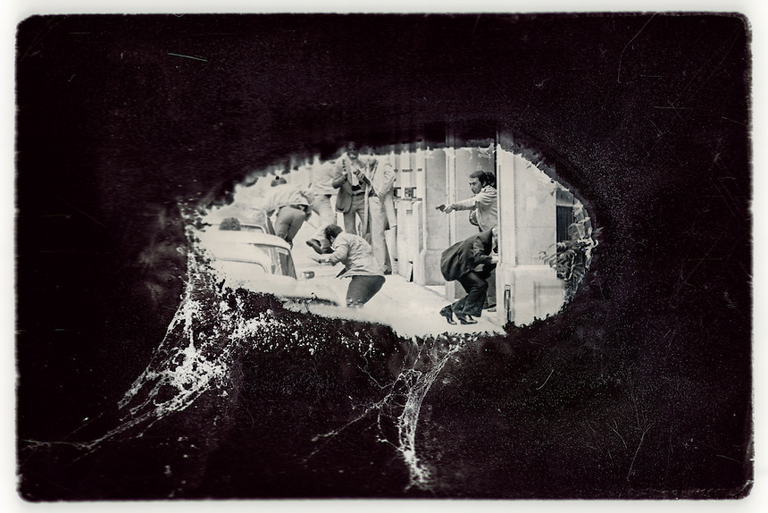 Undercover police officers shoot to death an Iraqi embassy guard who had just shot a French police officer in the streets of Paris in 1977. Originally a black-and-white negative, the image was mounted. The plastic slide page stuck to the center of the image, delaying its destruction by flood waters, which created this window-like effect. A historical photo, damaged artistically by flooding caused by Hurricane Sandy in October, 2012.