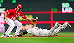 23 September 2010: Houston Astros outfielder Jason Bourgeois slides safely into second with Washington Nationals' infielder Danny Espinosa unable to handle the throw in the first inning at Nationals Park in Washington, DC. The Nationals defeated the Astros 7-2 for their third consecutive win, taking the series three games to one. Mandatory Credit: Ed Wolfstein Photo