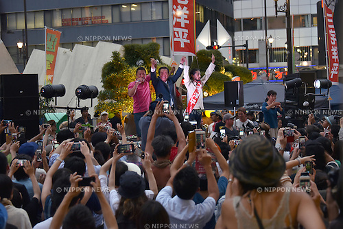 July 8, 2016, Tokyo, Japan - Ichiro Ozawa, center, Japans veteran lawmaker and co-leader of the opposition People's Life Party & Taro Yamamoto and Friends, answers to the cheering crowd, raising hands with independent candidate Yohei Miyake, right, and Taro Yamamoto, co-leader of Ozawas party, during a street campaign in Tokyo on Friday, July 8, 2016. Japanese voters go to the polls on Sunday, casting their ballots to elect half of the 242 seats in the upper chamber of the parliament. (Photo by Natsuki Sakai/AFLO) AYF -mis-