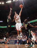 Dec. 17, 2010; Charlottesville, VA, USA; Virginia Cavaliers guard Sammy Zeglinski (13) goes to the basket between Oregon Ducks guard Jay-R Strowbridge (55) and Oregon Ducks guard Teondre Williams (22) during the game at the John Paul Jones Arena. Virginia won 63-48. Mandatory Credit: Andrew Shurtlef