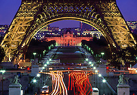Eiffel Tower at night with time exposed traffic Paris France