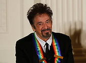 Actor Al Pacino, a 2016 Kennedy Center Honoree, listens to US President Barack Obama, in the East Room of the White House, December 4, 2016, Washington, DC. The 2016 honorees are: Argentine pianist Martha Argerich; rock band the Eagles; screen and stage actor Al Pacino; gospel and blues singer Mavis Staples; and musician James Taylor.<br /> Credit: Aude Guerrucci / Pool via CNP