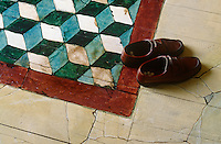 The geometric trompe l'oeil floor was inspired by both M C Escher's optical works and Ravenna mosaics