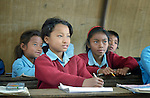Kabita Chepang, 10, in class at the Shri Pashupati Praja Primary School in the village of Tanglichowk, in the Gorkha District of Nepal. In the aftermath of the April 2015 earthquake that ravaged Nepal, the ACT Alliance helped people in this village with a variety of services, including latrines, emergency shelter, livelihood projects and school construction.<br /> <br /> Parental consent obtained for Kabita Chepang.