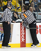 Scott Hansen on the phone during review of the non-goal on the first shift of the game. - The Merrimack College Warriors defeated the University of New Hampshire Wildcats 4-1 (EN) in their Hockey East Semi-Final on Friday, March 18, 2011, at TD Garden in Boston, Massachusetts.