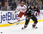 Matt Nieto (BU - 19), Garrett Vermeersch (NU - 9) - The Northeastern University Huskies defeated the Boston University Terriers 3-2 in the opening round of the 2013 Beanpot tournament on Monday, February 4, 2013, at TD Garden in Boston, Massachusetts.