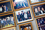 """Photos of clients, including celebrities and politicians, line the walls of the Yasuda family's """"Yakata-bune"""" pleasure boat business in Tokyo, Japan on 30 August  2010. .Photographer: Robert Gilhooly"""