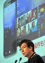 July 27th, 2011, Tokyo, Japan - Yasuyuki Higuchi, president and CEO of Microsoft Japan, speaks during a joint launch of Toshiba-Fujitsu IS12T, the worlds first Windows Phone 7.5, by KDDI, Fujitsu and Microsoft Japan in Tokyo on Wednesday, July 27, 2011. Manufactured by Fujitsu Toshiba Mobile Communications Ltd, the IS12T is Japan's first water- and dust-proof smartphone featuring Windows Phone 7.5, otherwise known as Mango. In addition to much smoother operability compared to conventional smartphones, the device offers the highest quality camera for a smartphone with 13.2-megapixels, and 32 GB of internal memory, while realizing a compact size. Users can not only read and edit Microsoft Office documents, but can also store and share data through Windows Live SkyDrive, a free-of-charge cloud service operated by Microsoft. The Windows phone will be available after September 2011.  (Photo by Natsuki Sakai/AFLO) [3615] -mis-