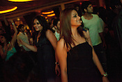 Young Indian women are seen dancing and having a good time at The club LAP located in Hotel Samrat in New Delhi, India. Photograph: Sanjit Das/Panos