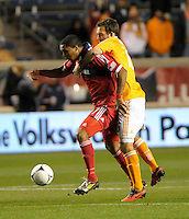 Houston midfielder Adam Moffat (16) pressures Chicago forward Sherjill MacDonald (7).  The Houston Dynamo defeated the Chicago Fire 2-1 in the Eastern Conference play-in game for the MLS Playoffs at Toyota Park in Bridgeview, IL on October 31, 2012.