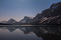 A moonlit nightscape taken at Bow Lake, Banff, Alberta on July 6/7, 2012. Illumination is from the waning gibbous Moon off camera at top. This is looking south toward the Moon. This is 25 seconds at f/4.5 and ISO 800 with the Canon 60Da and 10-22mm lens at 22mm.