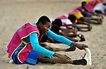 Boys stretch and do exercises before playing soccer in Timbuktu, the northern Mali city captured by Islamist forces in 2012 and liberated by French and Malian soldiers in 2013.