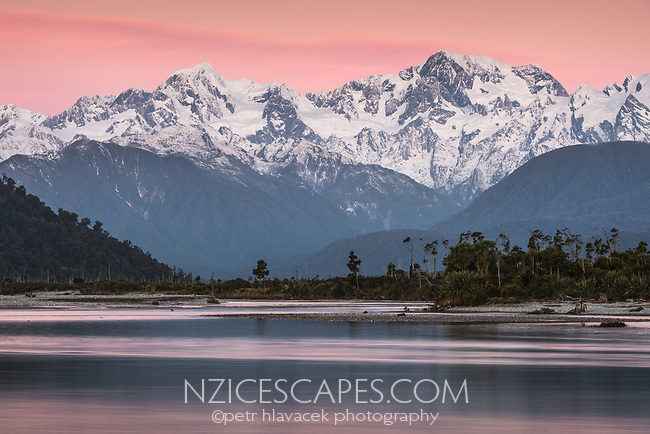Twilight with alpen glow over Southern Alps, Mount Tasman and Mount Cook with reflections in Cook River in foreground, Westland Tai Poutini National Park, UNESCO World Heritage Area, West Coast, New Zealand, NZ