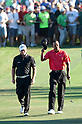 (L-R) Graeme McDowell (NIR), Tiger Woods (USA),.MARCH 25, 2012 - Golf :.Tiger Woods (the red shirt) of United States and Graeme McDowell (the black shirt) of Northern Ireland walk toward the 18th last green during the final round of the Arnold Palmer Invitational at Arnold Palmer's Bay Hill Club and Lodge in Orlando, Florida. (Photo by Thomas Anderson/AFLO)(JAPANESE NEWSPAPER OUT)