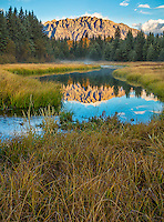 Grand Teton National Park, WY: Mount St John reflected in the still waters of the Snake River in fall