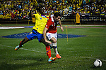 Ecuador's player Juan Paredes ( L) fights for the ball against Chile's player Eugenio Mena during their friendly match at the Citi-Field Stadium in New York, August 15, 2012. Photo by Eduardo Munoz Alvarez / VIEW.