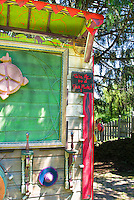 Fun shed wall with artistic ornaments, flea market finds, old things and decorative paint