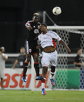 D.C. United defender Brandon McDonald (4) heads the ball against New England Revolution forward Jose Moreno (9)  D.C. United defeated The New England Revolution 3-2 at RFK Stadium, Saturday May 26, 2012.