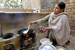 A woman cooks bread in the Punjab village of Kahna.
