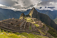 """Peak of Huaynapicchu (young mountain) in the distance. Machu Picchu, the ancient """"lost city of the Incas"""", 1400 CA, 2400 meters.  Discovered by Hiram Bingham in 1911. One of Peru's top tourist destinations."""