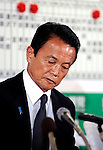 Taro Aso, president of Japan's ruling Liberal Democratic Party and prime minister of Japan, looks dejected at his party's headquarters after his party's poor showing in Japan's elections in Tokyo, Japan on Sunday 30 August 2009..