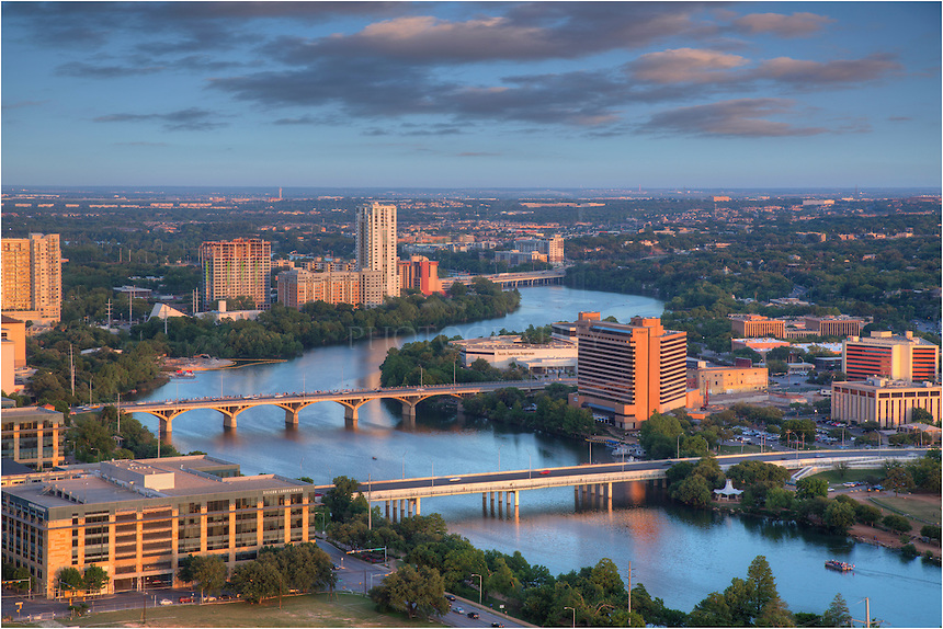 In the late afternoon, high above Ladybird Lake, I had the opportunity to photograph the Austin Skyline from the penthouse on the 42nd floor of the Springs Condominiums. From this amazing vantage point, you can see Ladybird Lake below, the Austin Hyatt, the Milago Condominiums, Congress Bridge, First Street Bridge, and many other important Austin buildings. This Austin skyline image also offers a view of I-35 in the distance.