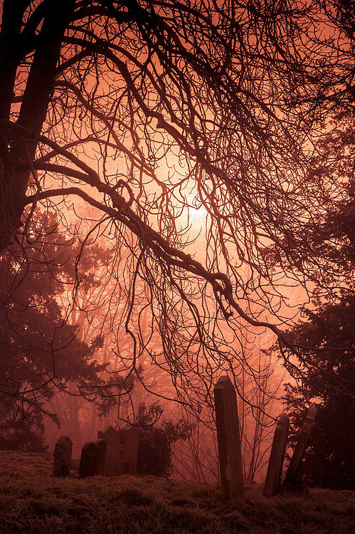 Misty view across a churchyard in Eye Suffolk England