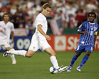 Chad Marshall #4 of the USA clears the ball from Walter Martinez #15 of Honduras during a CONCACAF Gold Cup match at RFK Stadium on July 8 2009 in Washington D.C.