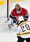 24 September 2009: Montreal Canadiens' goaltender Jaroslav Halak makes a second period save against the Boston Bruins at the Bell Centre in Montreal, Quebec, Canada. The Bruins edged out the Canadiens 2-1 after an overtime shootout in a pre-season matchup. Mandatory Credit: Ed Wolfstein Photo