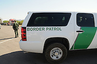 Nogales, Arizona - A Border Patrol agent looks toward the location of a permanent U.S. Customs and Border Protection (CBP) traffic checkpoint located on highway Interstate 19, north from Nogales and near the Town of Tubac, Arizona. Border Patrol checkpoints serve as inspection stations to detect illegal immigration and drug smuggling. Border Patrol agents assigned to fixed traffic checkpoints may stop a vehicle for brief questioning of its occupants. This checkpoint is part of the Border Patrol Tucson Sector. Photo by Eduardo © 2012